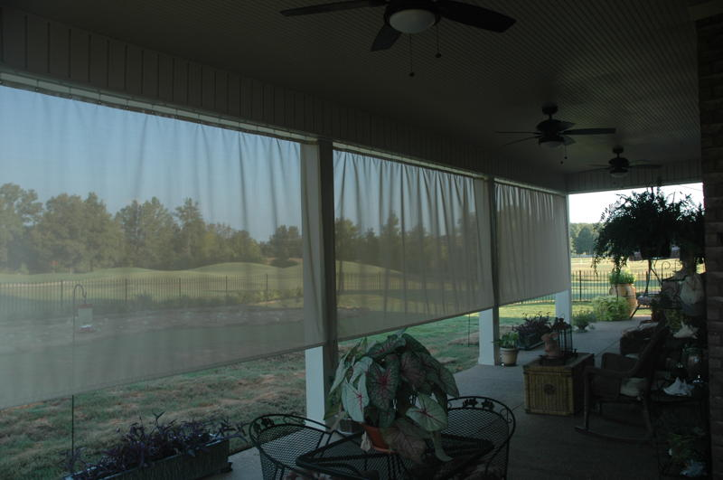 Outdoor curtains on covered patio