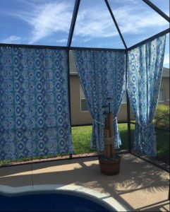 Outdoor curtains around pool